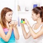 Two teenage girls polishing fingernails — Stock Photo