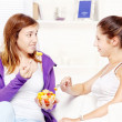 Royalty-Free Stock Photo: Teenage girls chating and eating fruit salad
