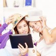 happy teenage girls having fun using touchpad computer — Stock Photo