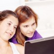 Two teenage girls using tablet computer — Stock Photo