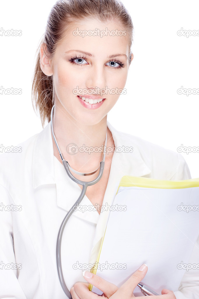 Portrait of a young female doctor with papers and stethoscope  Stock Photo #11861650