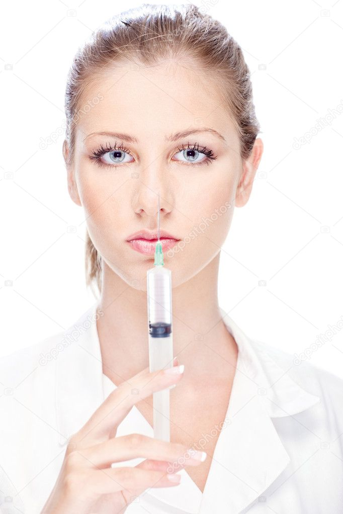 Handsome female nurse holding syringe — Stock Photo #11861667