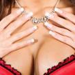Woman&amp;#039;s breasts and neck with a necklace - Stock Photo
