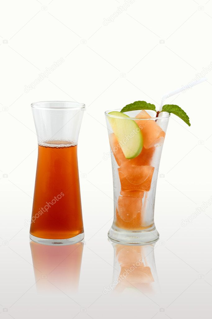 A glass of colorful punch with ice on isolate background.  Stock Photo #11898578