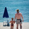 Royalty-Free Stock Photo: Father and child walking on the beach