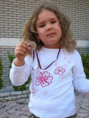 Girl with golden medal — Stock Photo