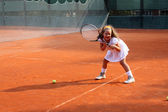 Girl playing tennis — Stock Photo