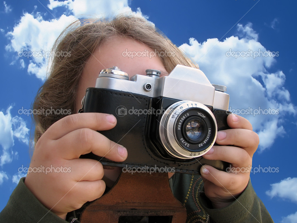 Girl with camera — Stock Photo #10930721