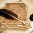 Stock Photo: Old book, quill and black ink