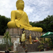 Big yellow Buddha's sculpture, Thailand — Stock Photo
