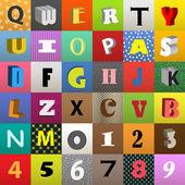 Set di lettere vettoriale nelle piazze di colore — Vettoriale Stock