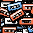Stock Vector: Vintage analogue music recordable cassettes. seamless background