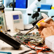 Repair  circuit boards - Stock Photo