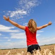 Girl in wheaten field — Stock Photo #10787321