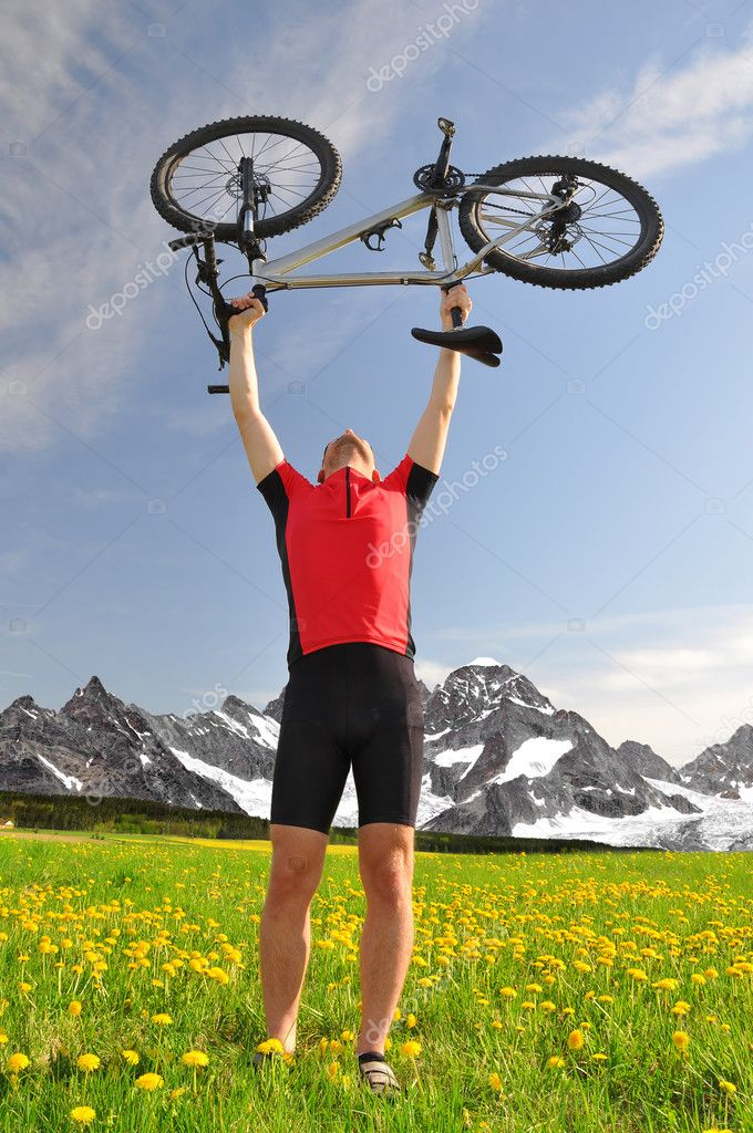 Biker with the mountain bike in the mountains — Stock Photo #10948137