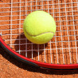 Stock Photo: Tennis ball and racket