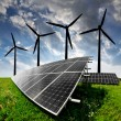 Solar energy panels and wind turbine - Stock Photo