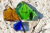 Three glass pieces on granite stone — Stock Photo