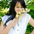 Foto Stock: Girl smell the flower