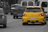 One yellow car in traffic jam — Stock Photo