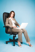 Young businesswoman in costume — Stock Photo