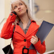 Businesswoman calling by phone — Stock Photo #11610340