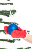 Woman's hands holding christmas toy — Stock Photo