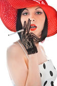 Woman with cigaret in her hand looking to the camera — Stock Photo