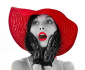 Pin-up woman with red hat and lips — Stock Photo