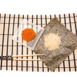 Making Sushi on a bamboo sushi mat - Stock Photo