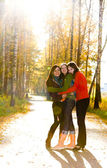 Three beautiful girls standing on the path in park — Stock Photo