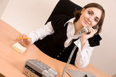 Businesswoman calling by phone at office — Stock Photo