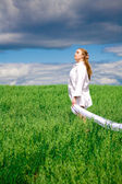 Young woman on a meadow — Stock Photo