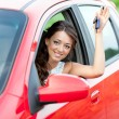 Happy driver in red car — Stockfoto