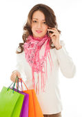 Woman with shopping bags calling by phone — Stock Photo