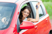 Happy driver in red car — Stock Photo