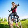 Six year old boy on a bike - Stock Photo