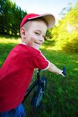 Happy boy rides a bike — Stock Photo