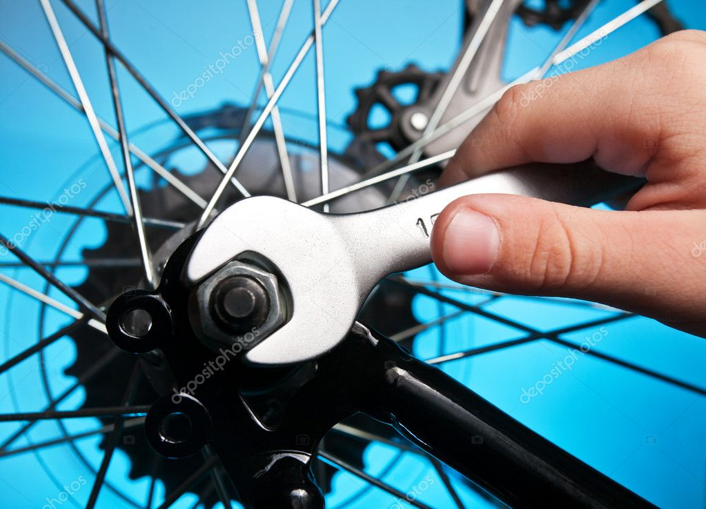 Repair of a bicycle with a wrench — Stock Photo #10898563