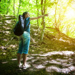 Young girl shows the way in forest — Stock Photo #11028646
