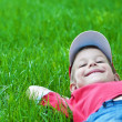 Boy laying on grass. Family picnic in spring park — Stock Photo