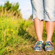 Female feet on the path in the park. — Stock Photo