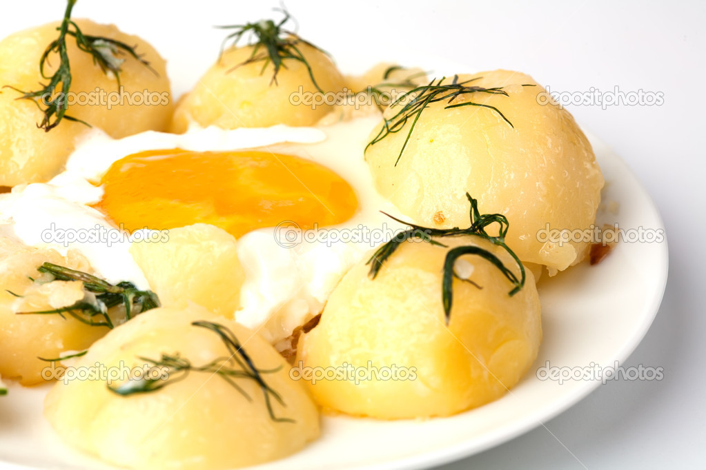 Food. Young potatoes with fried eggs  Stock Photo #11377925