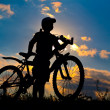 Cyclist silhouette on a sunset sky — Stock Photo