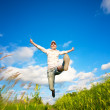 Fanny woman jumping over the blue sky — Stock Photo