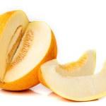 Sliced ripe aromatic melon on a white — Stock Photo