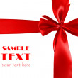Stock Photo: Big red holiday bow on white. crosswise
