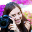 Woman is taking pictures in the flower — Stock Photo