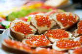 Sandwiches with red caviar on a plate. close-up — Stock Photo