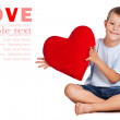 Happy boy with red heart in the hands. — Stock Photo #12344558